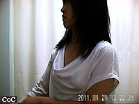 Hidden cam in a dressing room catches Asian gals changing c