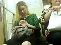 Sexy blonde rides the subway and gets her stunning legs fil