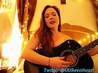 Redhead plays her guitar topless on live cam and checks it